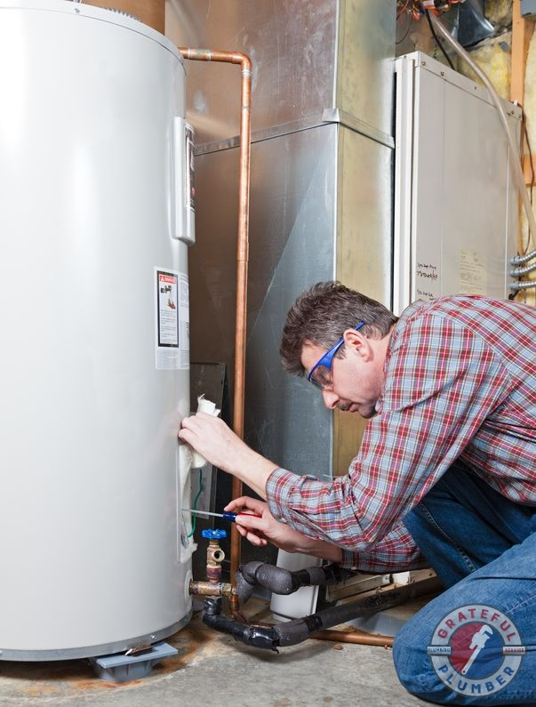 A Man Fixing a Water Heater.
