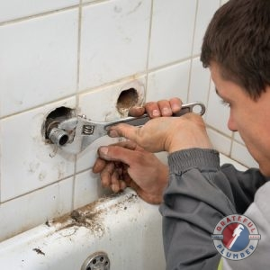 Plumbing Repairs Being Done on a Bathtub