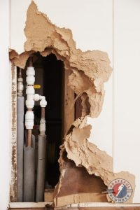 A Damaged Wall Exposing a Pipes That Have Burst
