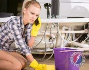 Woman Calling For Plumbing Services.