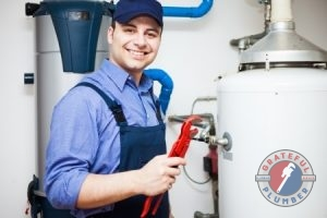 Man Repaing Gas and Electric Water Heaters