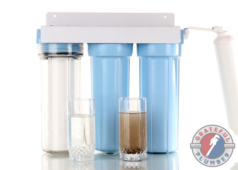 Three Stage Water Filters With Dirty Glass & Clean Glass of Water